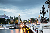 Pont Alexandre III in the evening light, Grand Palais in the background, Paris, France, Europe, UNESCO World Heritage Sites (bank of Seine between Pont de Sully und Pont d'Iena)