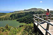 Young woman enjoying the view, Caldeira Funda, Island of Flores, Azores, Portugal