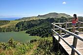 Young woman enjoying the view, Caldeira Funda, Island of Flores, Azores, Portugal
