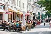 People sitting in street cafes in Hamburg Schanzenviertel, Hamburg, Germany