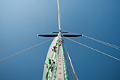 Sailboat Mast and Halyards Against Blue Sky, Low Angle View