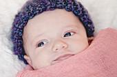 Newborn Baby in Purple Hat, Close Up, Portrait