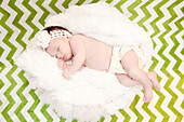 Sleeping Newborn Baby on Green Chevron Background