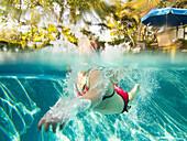 Girl Swimming in Pool, Underwater View