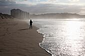 Girl Walking Along Seashore, Spain