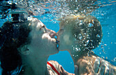 Mother and Son Kissing Underwater