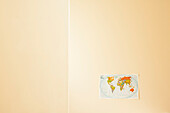 World Map Pinned to Bare Wall