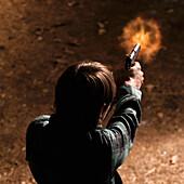 Man Firing a Handgun