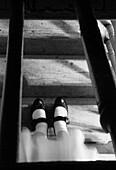 Young Girl with Mary Jane Shoes on Steps, Upside Down