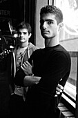 Two Young Men Standing on Urban Street at Night, Portrait, Brooklyn, New York City, USA
