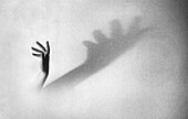 Hand with Fanned Out Fingers Casting Large Shadow
