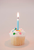 Vanilla Cupcake with Lit Candle