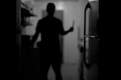 Man Holding Knife in Kitchen, Rear View, Silhouette