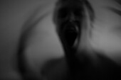Blurred Screaming Young Man