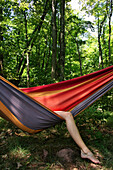 Woman With Legs Hanging out of Hammock