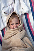 Young Boy Wrapped in Towel at Beach