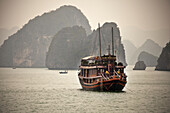 Traditional Wood Junk In The Ha Long Bay, Vietnam, Asia