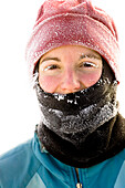Portrait Of Woman Runner With Frosted Face After Cold Early Morning Run In Idaho, Usa