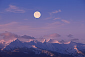 A Full Moon Sets Over The Chilkat Mountains And Lynn Canal At Sunrise Overlooking Lynn Canal, Inside Passage, Alaska