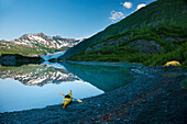 Kayak On The Beach In Shoup Bay With Shoup Glacier Reflected In The Water, Prince William Sound, Southcentral Alaska