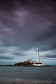'A White Lighthouse Under Storm Clouds; St. Mary's Island Northumberland England'