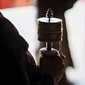 'China, Xizang, Hand Holding Incense Burner At Drepung Monastery; Tibet'