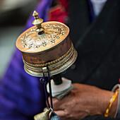 'China, Xizang, Tibet, Woman Holding Prayer Wheel; Lhasa'