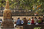 'India, Bihar, Buddhist Mediators Outside Mahabodhi Temple With Small Stupa On Left; Bodhgaya'