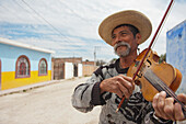 'Mexico, Man Playing Violin On Small Town Dirt Road; Guanajuato'