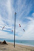 'Mexico, Jalisco, Acrobats Performing On Beach; Puerta Vallarta'