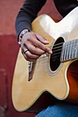 'Mexico, Guanajuato, Female Musician Strumming Acoustic Guitar; Guanajuato'
