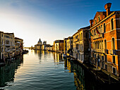 'Italy, Buildings Along Canal At Sunset; Venice'