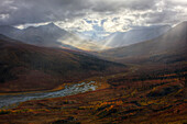 'Shafts Of Light Burst Through The Storm Clouds In Klondike Valley Of Tombstone Territorial Park;Yukon Canada'