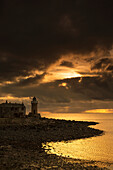 'Uk, Scotland, Dumfries And Galloway, Lighthouse On Coast With Stormy Clouds; Portpatric'