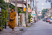 'Thailand, Monk Walking Down Street; Chiang Mai'