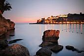 View across bay towards the old town of Ulcinj in the evening, Adriatic coastline, Montenegro, Western Balkan, Europe