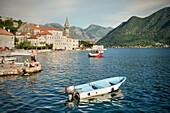 Fishermen and boats on the promenade of Perast, Bay of Kotor, Adriatic coastline, Montenegro, Western Balkan, Europe, UNESCO