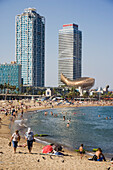 People on beach, Barcelona, Spain