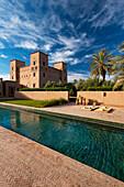 Swimming pool and main kasbah of Dar Ahlam Hotel, Skoura, Morocco