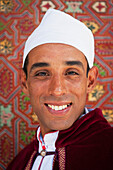 Portrait of man in traditional outfit, Marrakech, Morocco