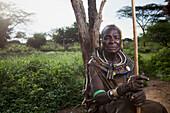 Portrait of traditionally dressed senior woman from Pokot tribe, Lake Baringo, Rift Valley, Kenya