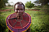 Portrait of traditionally dressed woman from Pokot tribe, Lake Baringo, Rift Valley, Kenya