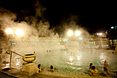 People Enjoying One Of The Outdoor Pools In Szechenyi Baths, Budapest, Hungary