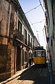 Tram on street, Alfama, Lisbon, Portugal