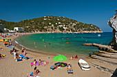 People relaxing at beach, Cala de San Vicente, Ibiza, Spain