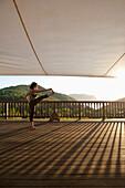 Lady doing yoga at Ibiza Yoga, Benirras, Ibiza, Spain