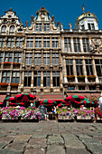 People eating and drinking in outside cafes in Grand Place, Brussels, Belgium