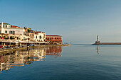 View of coastline and harbor at dawn, Chania, Crete, Greece
