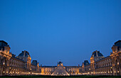 Exterior of Louvre Museum at dusk, Paris, France