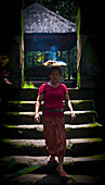 Alex, Adams, Carrying, Outdoors, Day, Front View, Full Length, Walking, Young Women, One Person, Balance, Architecture, Travel Destinations, Traditional Culture, Travel, Traditional Clothing, Journey, Real People, Steps, Roof, Ubud, Indonesia, Bali, Open